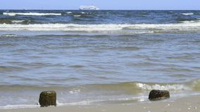 Stone at a beach with soft break-wave at the Baltic sea Stock Photography