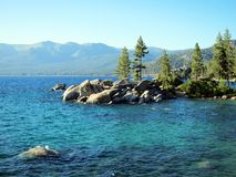 Stone beach, turquoise water at Lake Tahoe, Nevada Royalty Free Stock Image