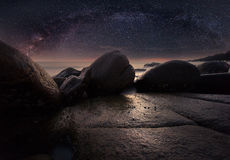 The stone beach under starry night clearly with milky way Stock Photography
