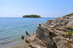Stone beach and view of the island in the Sea Royalty Free Stock Photo