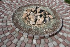 Stone bed. Round tiled pattern of stone on the pavement Stock Photo