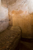 Stone bed in a house in Pompeii. Excavated stone bed in a house in Pompeii Stock Photography