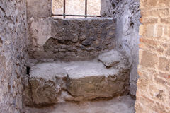 Stone Bed in Pompeii. A stone bed in the Roman city of Pompeii.  It was completely buried by an eruption of Mount Vesuvius in AD 79 Stock Photography