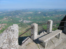 Stone bench. For the fence on the high mountain in San Marino Royalty Free Stock Photography