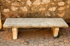 Stone bench. On a bus stop in Cannes, French Riviera royalty free stock photo