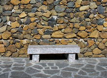 Stone bench against stone wall. In temple, Yunnan, China stock photos
