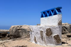 Stone bench. Blue and white stone bench at the Atlantic coast royalty free stock photography