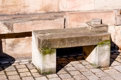 Stone bench. With books in front of a sandstone wall Royalty Free Stock Photography