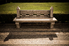 Stone bench in a city park. Garden architecture. tinted Stock Photography