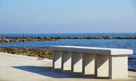 Stone bench by the coast Royalty Free Stock Photo