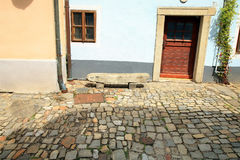 Stone bench on a cobbled street Royalty Free Stock Photography