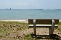 Stone bench facing sea Stock Photo