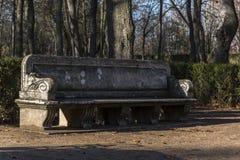 Stone bench in the garden De La Isla in Aranjuez. Madrid, Spain Stock Image