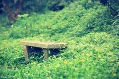 Stone bench in green grass Stock Photos