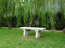 Stone bench on green grass Royalty Free Stock Image