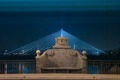 Stone bench on  illuminated bridge by night. In Warsaw (Poland, Europe Royalty Free Stock Photos