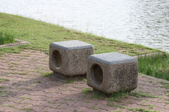 Stone bench beside lake. Royalty Free Stock Images