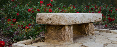 Stone bench. In the middle of a rose garden Royalty Free Stock Photo