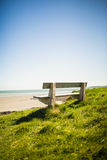 Stone bench near the sea Royalty Free Stock Images