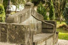 Stone bench. Old stone bench in Sinaia, Prahova, Romania stock photography