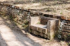 Stone bench park. Stone bench in park outdoors royalty free stock photography