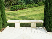 Stone bench in the park Royalty Free Stock Image