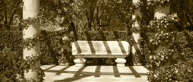 Stone bench in a park. Sepia tone Royalty Free Stock Photos