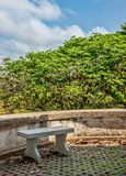 Stone bench. In the park stock image