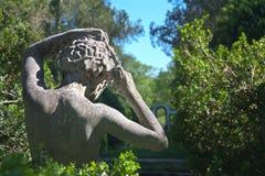 Statue in formal garden. Back of statue in formal garden at Oatlands Plantation in Leesburg, Virginia in Loudoun County Stock Images