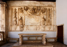 Stone bench and sculptures royalty free stock image