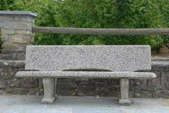 Stone bench in the square. Stone Bench at Torre Bormida in front of the Parish Church royalty free stock photo