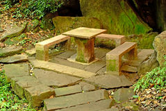 Stone bench and stone table Royalty Free Stock Image