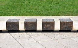 Stone bench with wooden seats Stock Photography