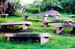 Stone benches on a grassy hill Stock Image