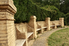 Stone benches in a park. green bush. A beautiful park in Rome, Italy. stone benches in a park. green bush royalty free stock image
