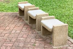 Stone benches seats. In the Park stock photo