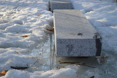 Stone benches in snow Stock Photo