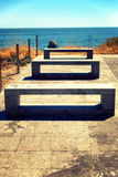 Stone benches in the sun at the beach. Portugal Stock Photos