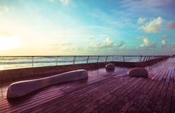 Stone benches and wooden deck royalty free stock images