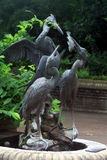 Stone Birds. Statue of three storks at the plant garden Stock Images