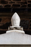 Stone bishop's insignia on a grave Stock Photos