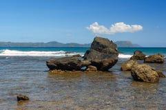 Stone on black sand volcanic beach Stock Photo