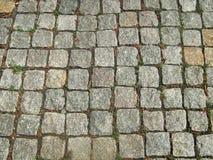 Stone block pavement. Grey background Stock Images