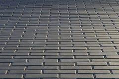 Stone block paving. Stone gray block paving background Stock Photos