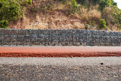 Stone block to prevent landslides along the road. Stock Photo