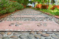 Stone block walk path in the park. Select focus with shallow depth of field royalty free stock photo