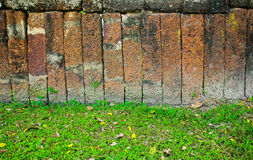 Stone block wall with grass Stock Photography
