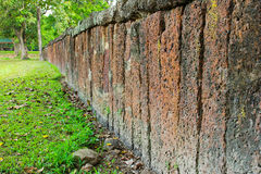 Stone block wall with grass Royalty Free Stock Images