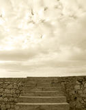 A stone block wall with a stairway, sepia hue Royalty Free Stock Photography