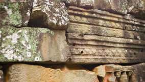 Stone blocks from the ancient wall of the temple. Angkor, Cambodia stock video footage